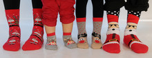 Family Of Four Wearing Christm...