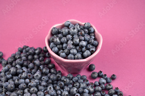 Foto op Aluminium Vruchten Blueberries in a bowl stock images. Blueberries on a purple background. Healthy summer fruit