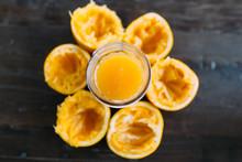 Juiced Orange Peels In A Circle Around Juice