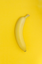 Creative View Of A Banana On A Paper Yellow Background.