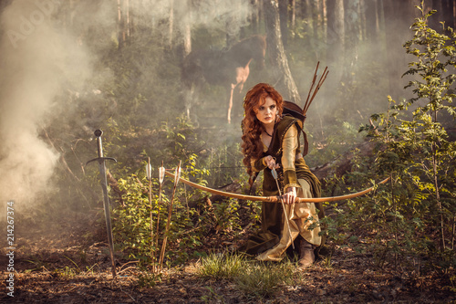 Fantasy medieval woman hunting in mystery forest Fototapeta