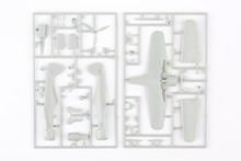 Kit For Assembling Gray Plastic Airplane Model On White Bsckground