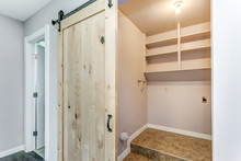 Open Barn Door To A Small Laundry Room.