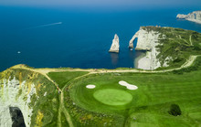 Drone View Of A Cliff Side Golf Course Next To The Ocean In Etretat Normandie France