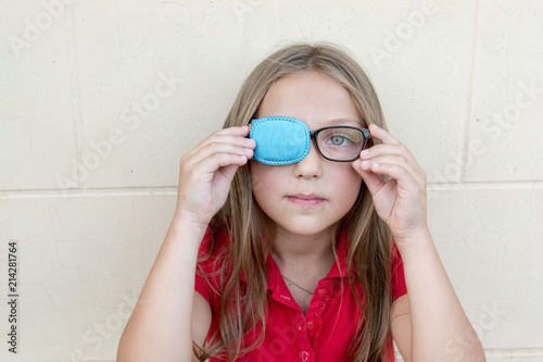 Fényképezés .Child in glasses with Occluder. Ortopad Girls Eye Patches nozzle for glasses fo