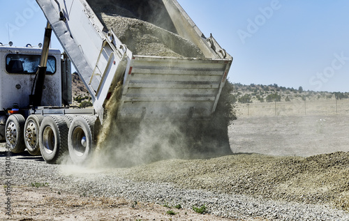 Photo Dump Truck spreading Gravel on Driveway