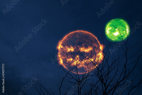 halloween sun green orb back silhouette tree and night sky