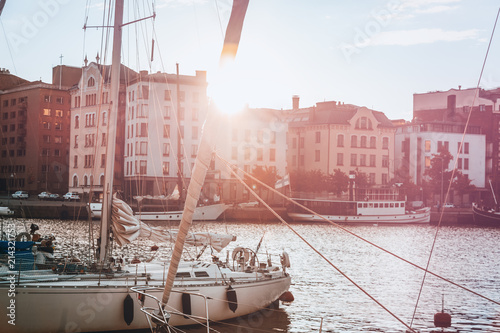 Canvas Print A beautiful city landscape, a port with boats in the rays of the setting sun, He