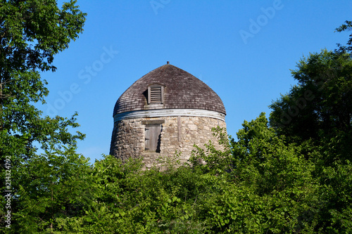 Fotografie, Obraz  Old wind powered stone grist mill without it's original sails (windmill) with bl