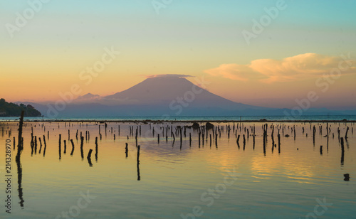 amazing beautiful scenic view from the beach of of active volcano Mount Agung in Bali island of Indonesia on sunset in Asia travel destination