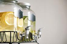 Fresh Citrus Lemonade With Lemons And Limes In Beverage Dispenser
