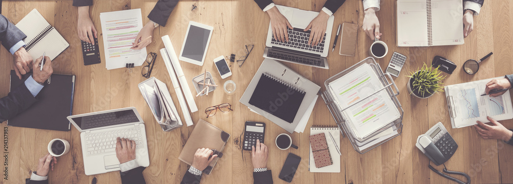 Fototapety, obrazy: Top view of business people working in office
