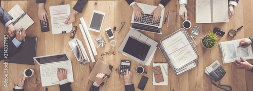 fototapeta na ścianę Top view of business people working in office