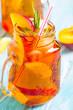 peach ice tea fresh mint rosemary wooden background