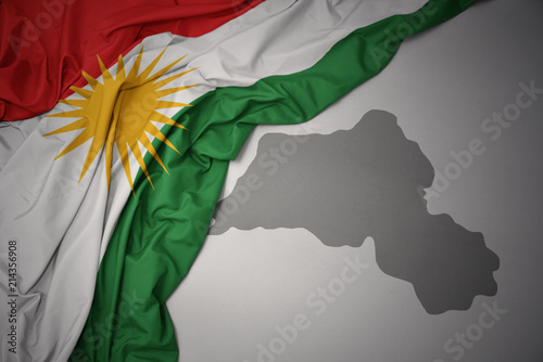 Fotomural  waving colorful national flag and map of kurdistan.