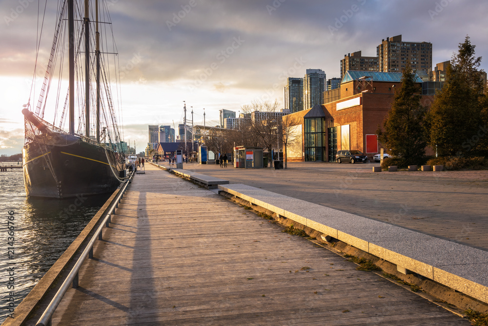 Fototapety, obrazy: Boardwalk on Toronto Waterfront Lit by an Autumnal Setting Sun. ON, Canada.