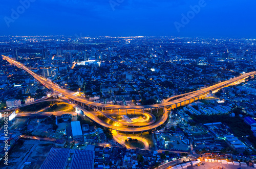 Poster Nacht snelweg Bangkok Expressway top view, Top view over the highway,expressway and motorway at night, Aerial view interchange of a city, Shot from drone, Expressway is an important infrastructure in Thailand