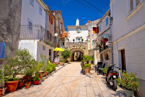Obraz Town of Omisalj old mediterranean street view - fototapety do salonu