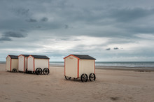 Vintage Beach Huts On A Cloudy Day
