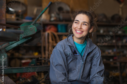 young woman mechanic in a workshop Canvas Print