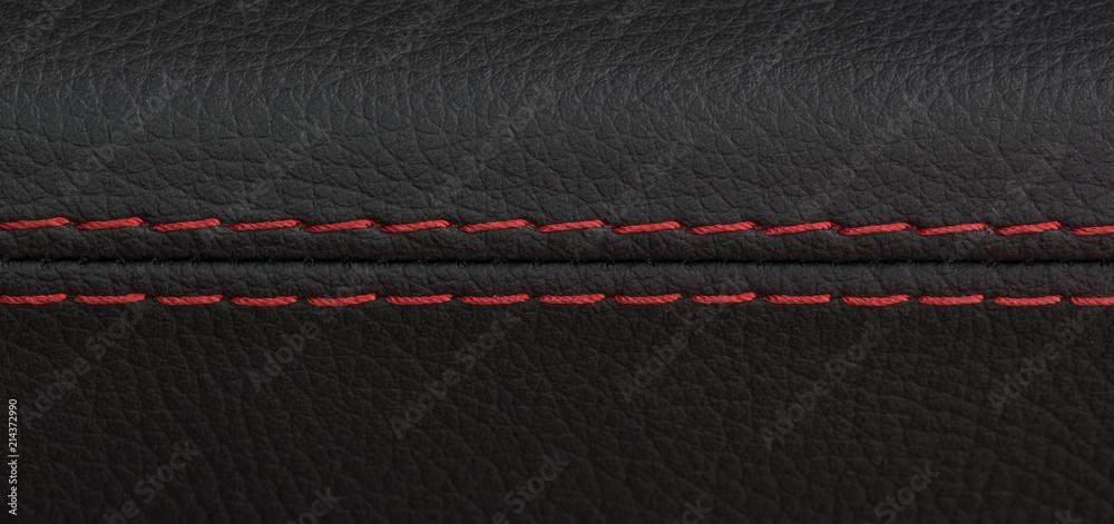 Fototapeta closeup shot of black leather car seat with red stitch,sports luxury car