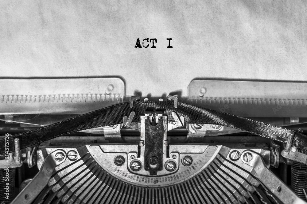 Fototapeta ACT I, typed text on a vintage typewriter, screenplay title heading. On old paper with ink. writer's idea