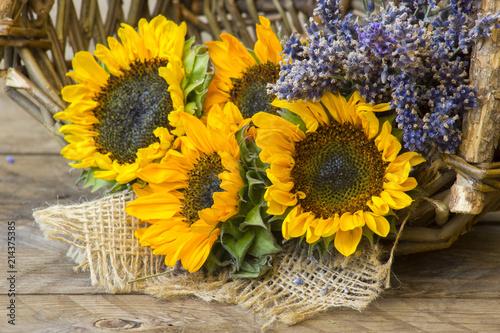Fototapeta sunflowers and lavender in a basket obraz