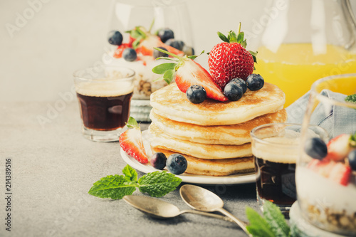 Obraz na plátně Breakfast composition with fresh pancakes and berries on light gray concrete background