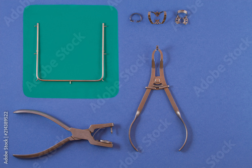 Tools for installing the cofferdam lying on a blue background. Canvas Print