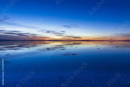 Uyuni reflections are one of the most amazing things that a photographer can see. Here we can see how the sunrise over an infinite horizon with the Uyuni salt flats making a wonderful mirror.