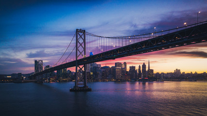 Aerial Cityscape view of San Francisco and the Bay Bridge with Colorful Sunset
