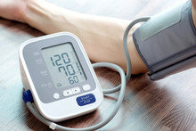 Man Check Blood Pressure Monitor And Heart Rate Monitor With Digital Pressure Gauge. Health Care And  Medical Concept