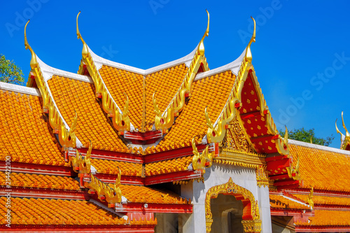 Deurstickers Bedehuis The orange roof of the Marble Temple, also known as Wat Benhamabofit in Bangkok. Thailand