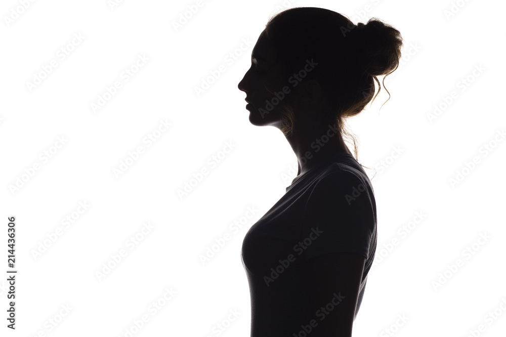 Fototapeta silhouette profile of young woman on a white isolated background