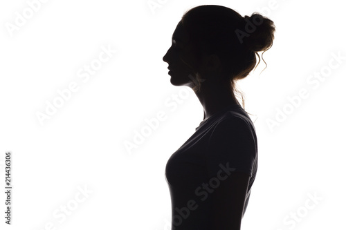 Fototapeta silhouette profile of young woman on a white isolated background obraz