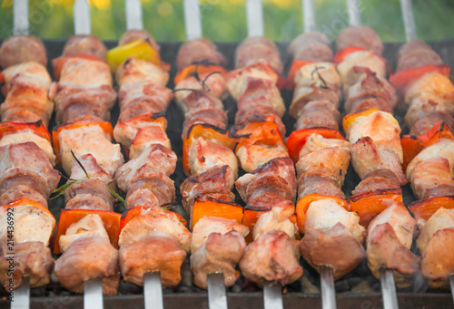 Staande foto Vlees Meat on sticks grilled outdoors