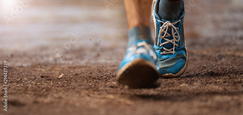 Fotomural Trail running action close up of running shoes in action