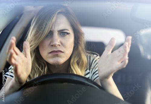 Valokuva Angry woman driving a car.