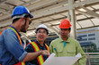 group of engineer, technician and architect with safety helmet planning about building plan with blueprint in modern city building background, construction site, business, industry and worker concept