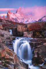 View of Mount Fitz Roy and the waterfall at sunrise,  Los Glaciares National Park, Andes, Patagonia, Argentina
