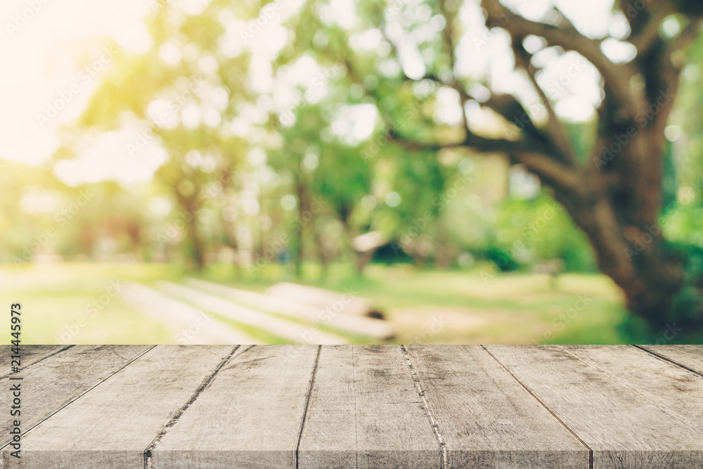 Fototapety, obrazy: Empty wooden table top and green bokeh display montage for product with space.