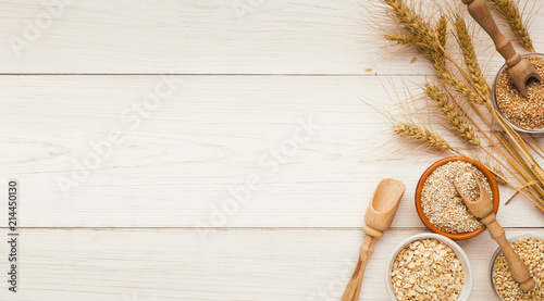 Obraz Cereals and legumes assortment on wooden table - fototapety do salonu
