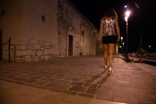 Night Scene At The Port With A Girl In A Miniskirt That Walks