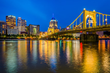 The Roberto Clemente Bridge and Pittsburgh skyline at night, seen from Allegheny Landing, in Pittsburgh, Pennsylvania.