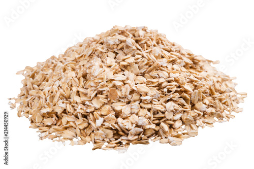 Heap of raw oat flakes isolated