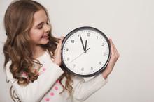 Little Girl Holding Big Clock ...