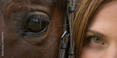 Fototapeta Horse muzzle and woman's face close-up with expressive eyes obraz