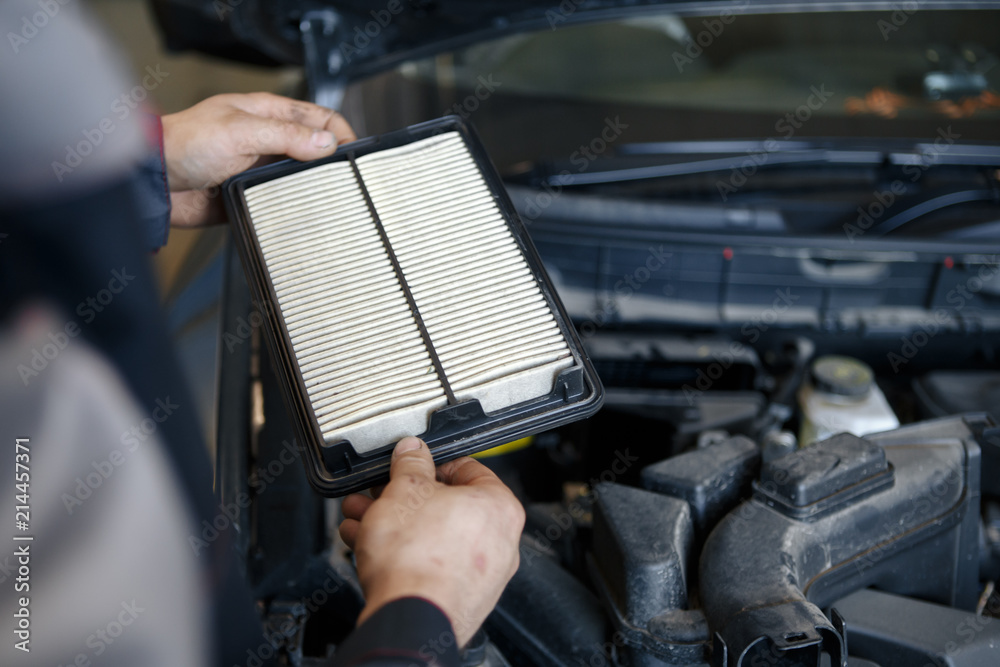 Fototapeta Hand a man change and check air filter of car in the engine room