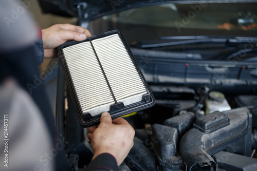 Obraz Hand a man change and check air filter of car in the engine room - fototapety do salonu