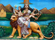 wall art of Indian Hindu Goddess Durga with weapons sitting on Lion ,to kill the demon